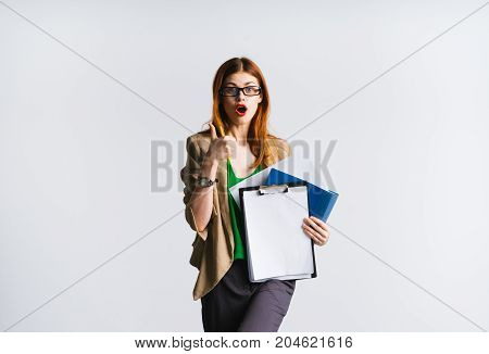 Young businesswoman  teacher holding a A4 mock up sheet and showing thumb up