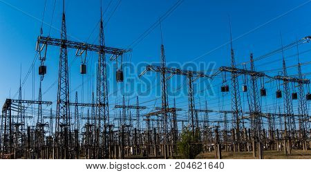 Electric substation on a background of the coming sun