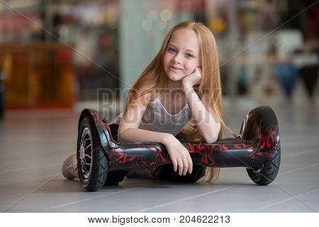 Happy And Smiling Girl With Mini Segway At Trading Mall. Teenager Riding On Hover Board Or Gyroscoot