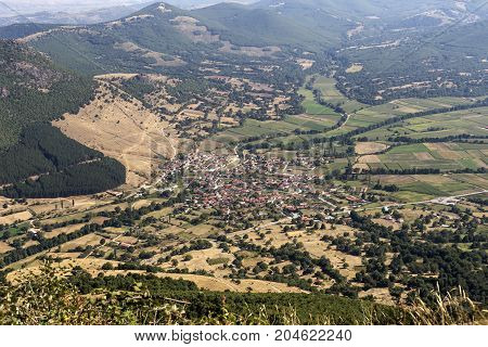 View of the mountains, the village from a height on a sunny day  (northwest Greece, Macedonia)