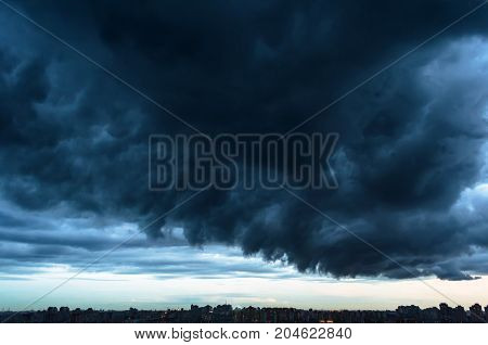 The Squall Gate And Thunderclouds Above The City In The Evening Twilight