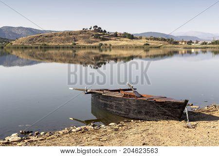 Boat moored to the shore on the lake Zazari (northwest Greece, Macedonia)