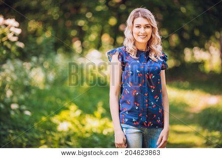 Portrait of a smiling woman in a park