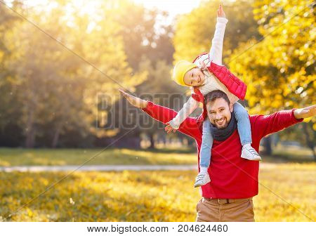 happy family father and child girl daughter playing and laughing in autumn park
