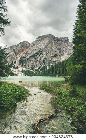 Lago di Braies or Pragser Wildsee in Fanes-Sennes-Braies Nature Park. Mountain lake with clear emerald waters surrounded by green forests in Valle di Braies in Dolomite Alps in North Italy