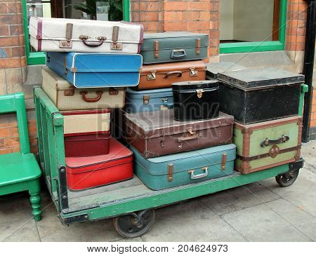 A Stack of Vintage Cases on an Old Porters Trolley.