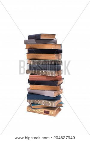 Stack of old books isolated on white background front view.