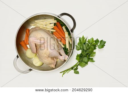 Chicken bouillon set ingredients for cooking simple chicken bouillon put in a pan view from above
