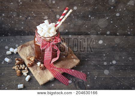cup of hot chocolate, cocoa with marshmallows and popcorn on wooden background. Cup of hot drink Winter and Christmas holidays concept.