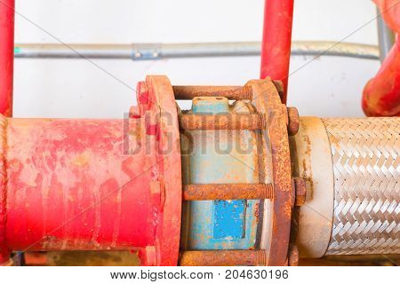 joint pipe system Old big plumbing red which has dust dirty inside of building industrial