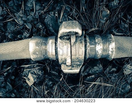close up photo of fire hose coupling.