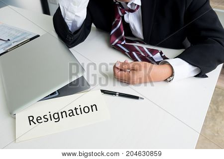 Feeling sick and tired. Frustrated middle aged businessman sitting at office desk