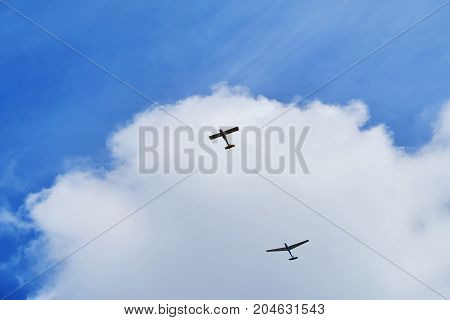 the plane, crossing the cloud vignette. Military aircraft
