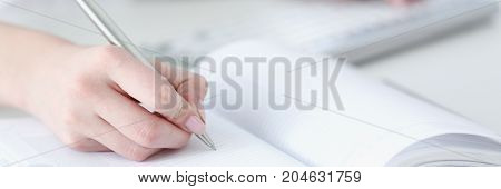 Female Hand Holding Silver Pen Ready To Make Note