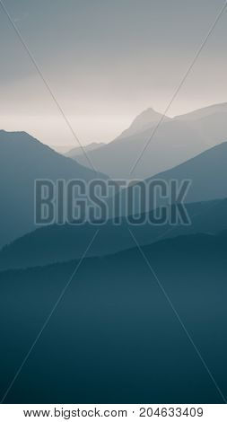 An Inspiring Mountain Landscape In Tatry, Slovakia. Vivid, Gradient Scenery With Perspective In Blue