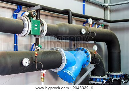 Thermometer, Pipes And Faucet Valves Of Heating System In A Boiler Room
