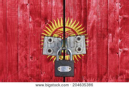 Kyrgyzstan flag on door with padlock close