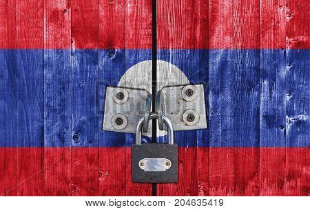 Laos flag on door with padlock close
