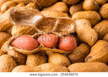 Close up of Peanuts on plie of peanuts background.