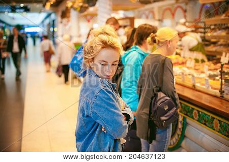 Young Beautiful Woman In Jeans Clothes In Business Space Of Shopping Center. Portrait Of A Girl With