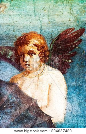 Ancient painted fresco wall of Cupid, detail of Venus in Conchiglia fresco at the ancient Roman city of Pompeii, which was destroyed and buried by ash during the eruption of Mount Vesuvius in 79 AD