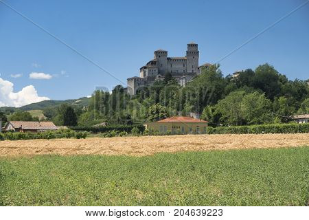 The medieval castle of Torrechiara (Parma Emilia Romagna Italy) and vineyards at summer