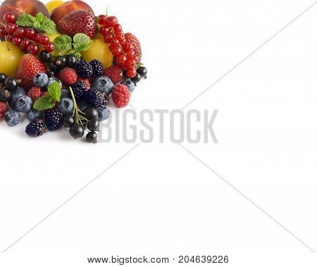 Ripe blueberries raspberries black currants red currants blackberries strawberries yellow plums and peaches on white background. Berries with copy space for text. Background berries. Various fresh summer berries.