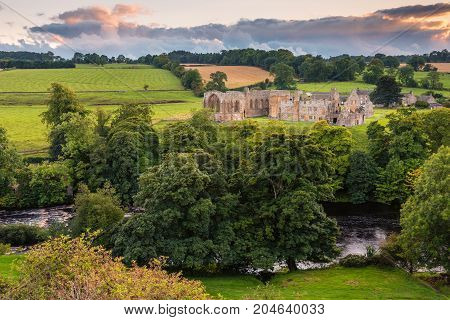 River Tees flows past Egglestone Abbey, the remains of  which are on the banks of river, near Barnard Castle in County Durham