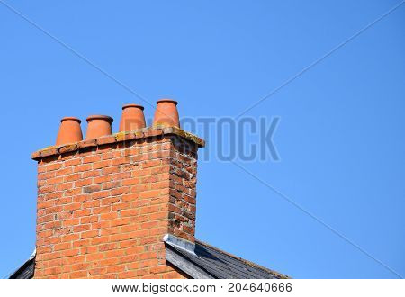 A chimney stack with four chimney pots