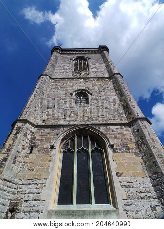 The clock tower of a parish church in High Wycombe