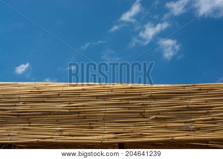 Mat made of straw used as a wall outdoors