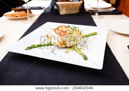 Chilean sea-bass in papilliote on a plate