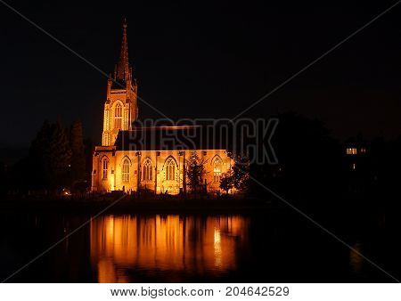 Marlow Church reflected in the River Thames at night