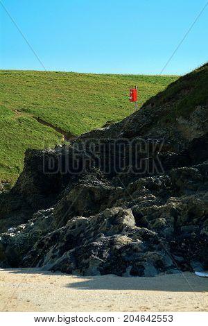 A lifebelt by a beach in Cornwall
