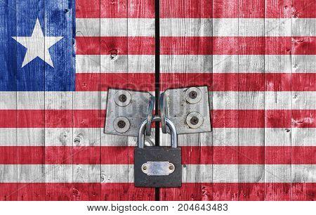 Liberia flag on door with padlock close