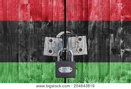 Libya flag on door with padlock close
