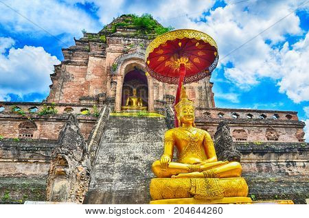 Wat Chedi Luang temple and Buddha statue in Chiangmai Thailand