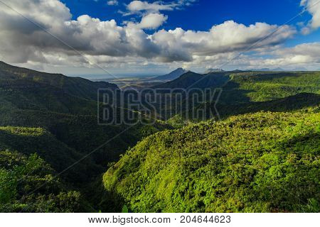 Beautiful view of the green mountains of the tropical island of Mauritius.