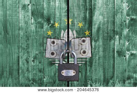 Macau flag on door with padlock close
