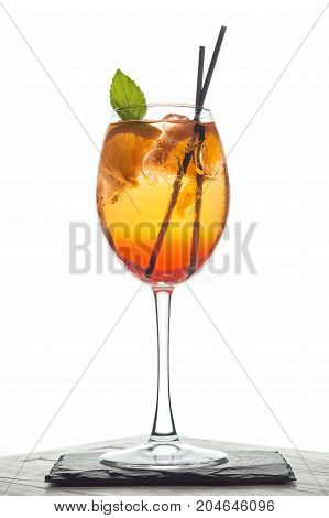 Glass of aperol spritz cocktail with mint and orange.
