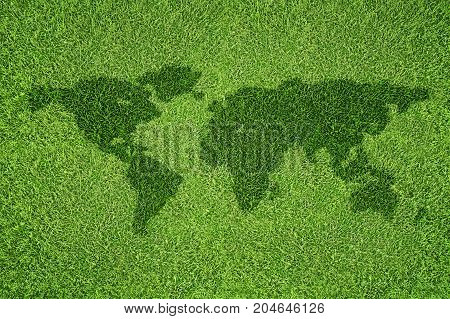 Illustration of world map shape on green grass field background