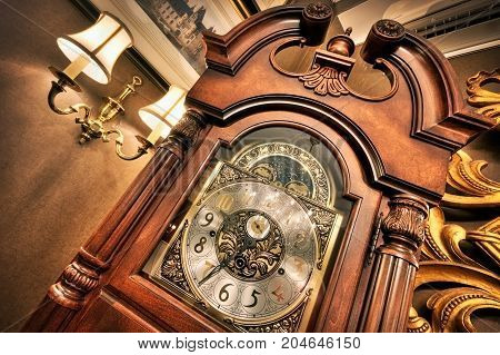 High Dynamic Range photo. Old antique clock in an interior