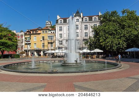 PLOVDIV, BULGARIA - SEPTEMBER 1, 2017:  Panoramic view of cental street and fountain in front of City hall in city of Plovdiv, Bulgaria