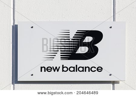 Merignac, France - June 5, 2017: New Balance logo on a wall. New Balance is an American multinational corporation based in the Brighton, USA