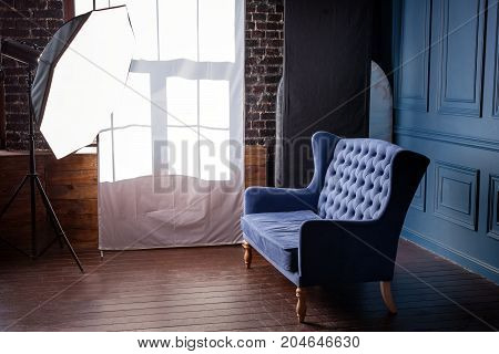 Antique wood sofa couch in vintage room. Classical style armchair in photo studio with lightning equipment