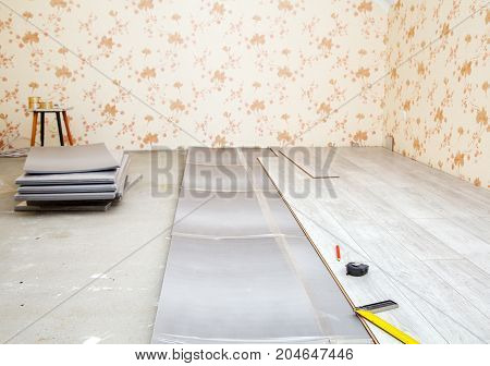 laminate boards prepared for laying on the floor in the room