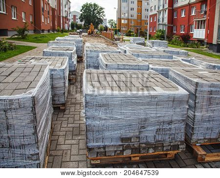 construction of a new modern road with paving slabs in the city on summer day