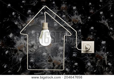 Glowing LED lamp in a house on background of incandescent bulbs