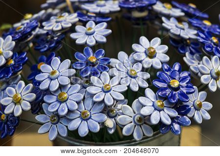 Traditional Hungarian ceramic flowers to decorate the interior of gardens and flower pots