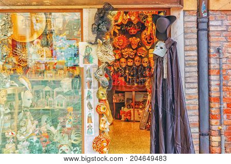 Venice, Italy - May 11, 2017 : Entrance To Old Private Lacquer With Carnival Venetian Masks. Italy.